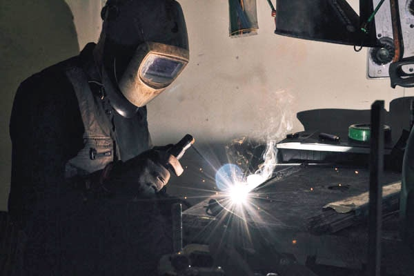 Person welding for manufacture